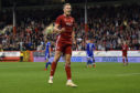 Sam Cosgrove celebrates his third goal and Aberdeen's fifth