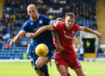 Aberdeen's Ryan Hedges (right) holds off Jordon Forster