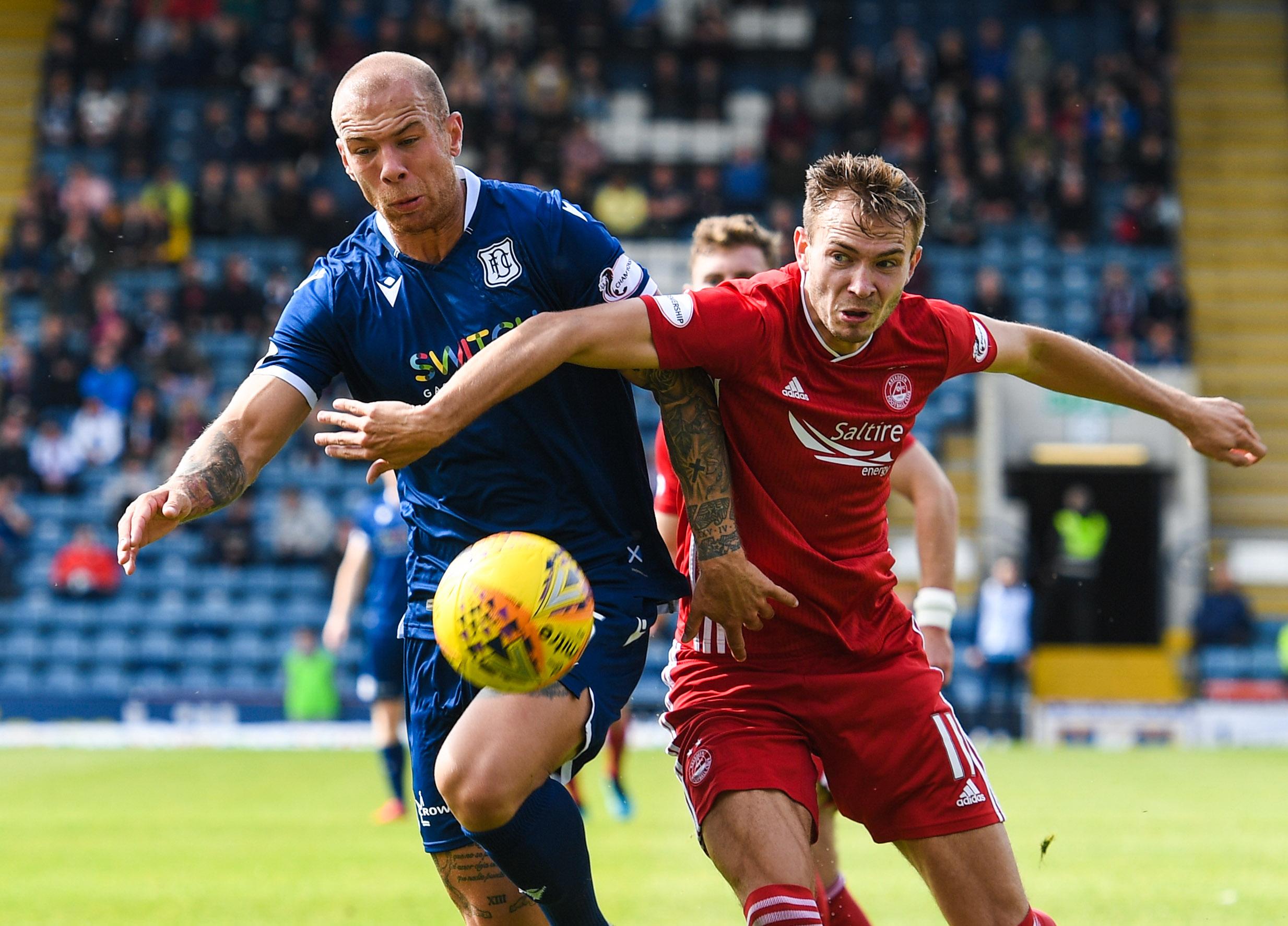 Aberdeen's Ryan Hedges (right) holds off Jordon Forster