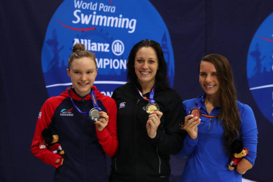 Sophie Pascoe of New Zealand (gold), Toni Shaw of Great Britain (silver) and Elizabeth Smith of USA bronze after the Women's 100m Butterfly S9 Final on Day Three of the London 2019 World Para-swimming Allianz Championships.