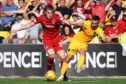 Aberdeen's Dean Campbell competes with Steven Lawless during the Ladbrokes Premiership match between Livingston and Aberdeen.