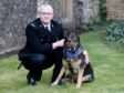Police dog Finn with his handler PC Dave Wardell (Jonathan Brady/PA)