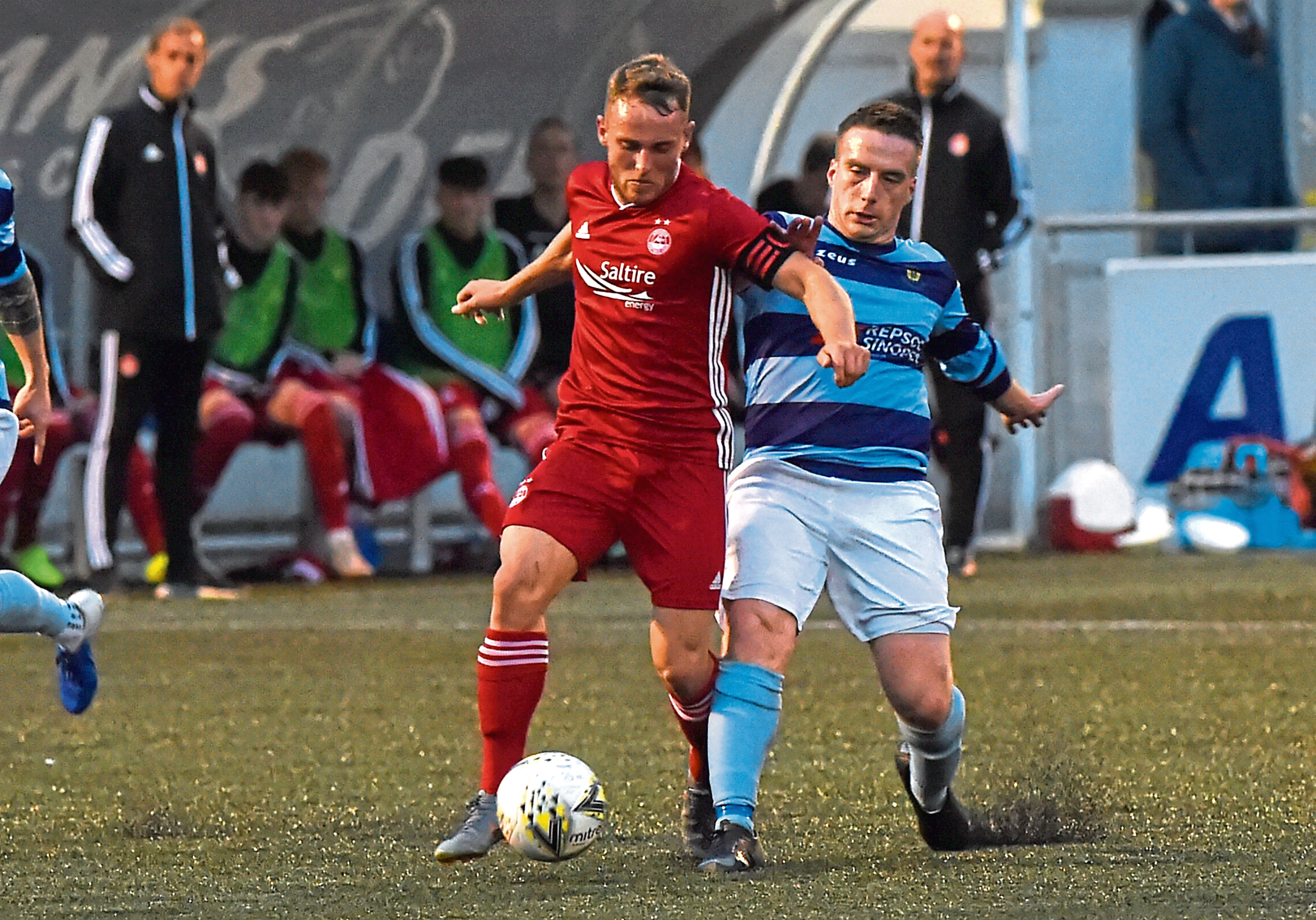 Seb Ross, left, in action for former club Aberdeen Picture by Kenny Elrick