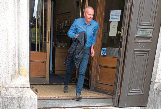 Gavin Pirie running out of Aberdeen Sheriff Court
