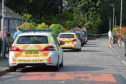 Officers at the scene in Ellon last week