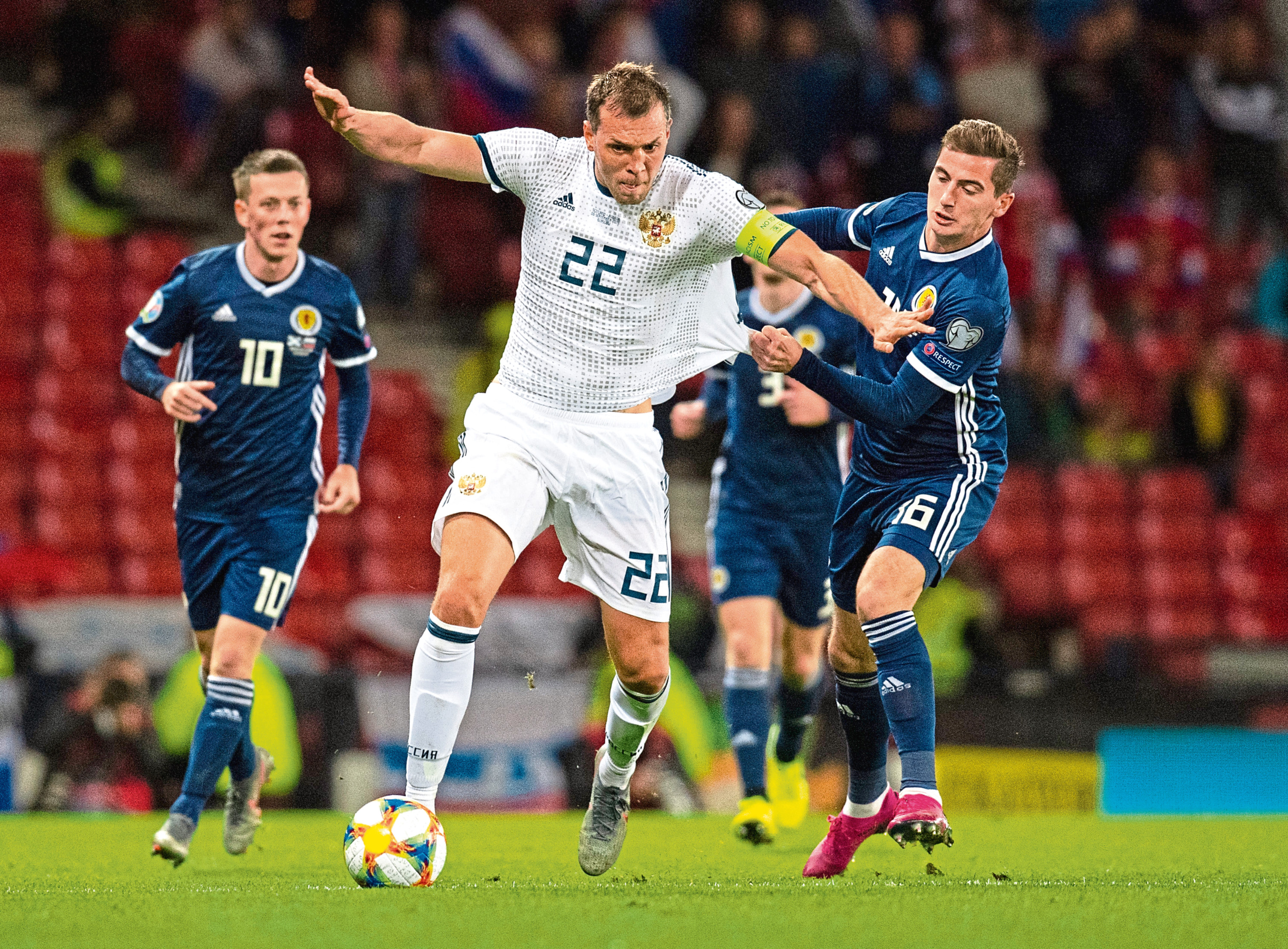 Scotland's Kenny McLean and Artem Dzyuba during the Euro 2020 qualifier between Scotland and Russia at Hampden Park.