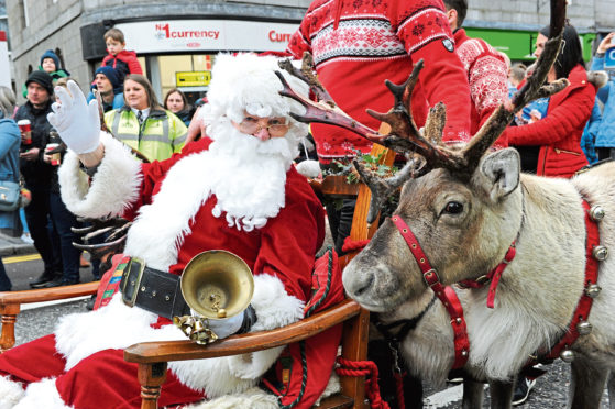 Santa and one of his reindeer during last year's parade