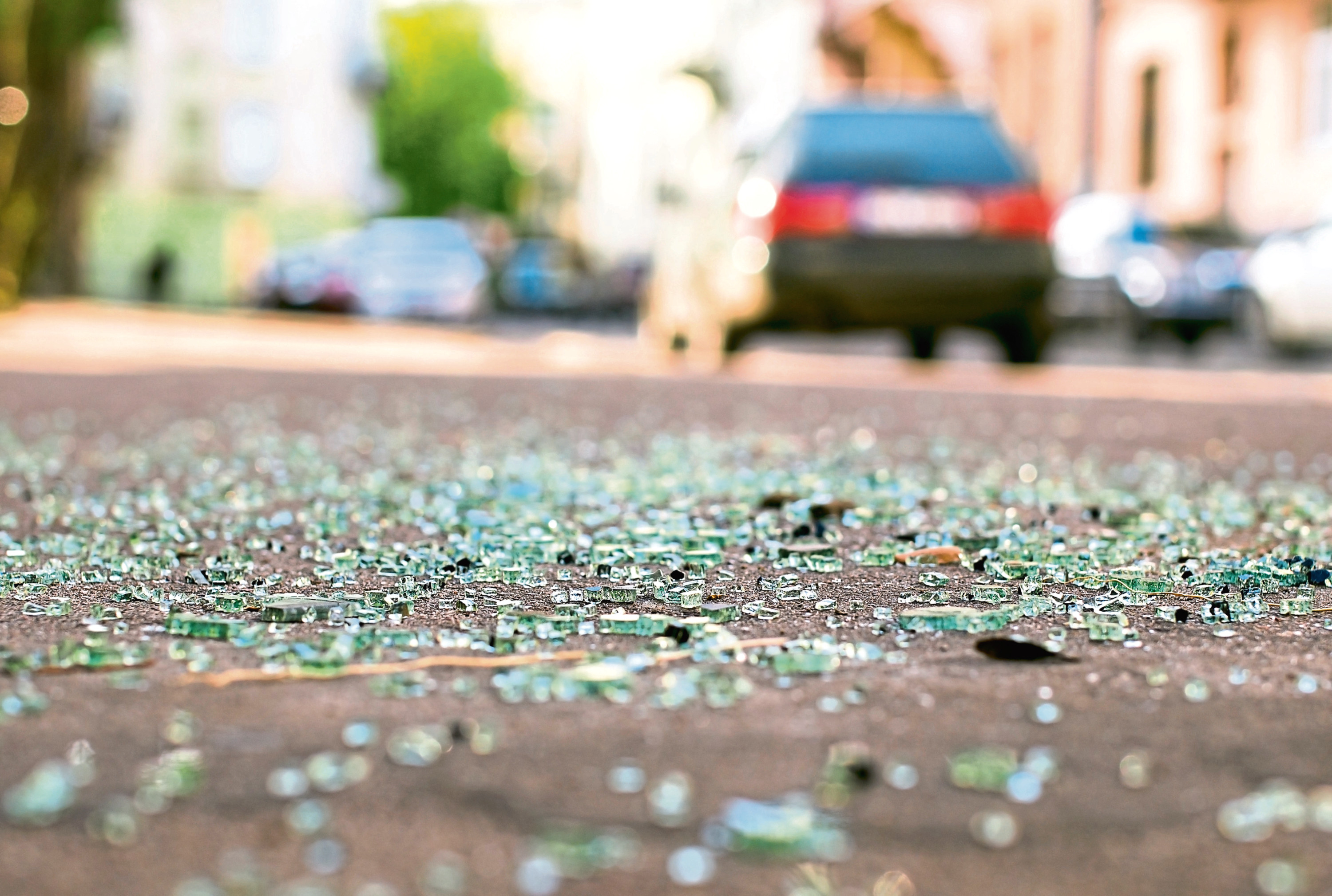 Shards of car glass on the street. iStock. Downloaded 11/09/19.