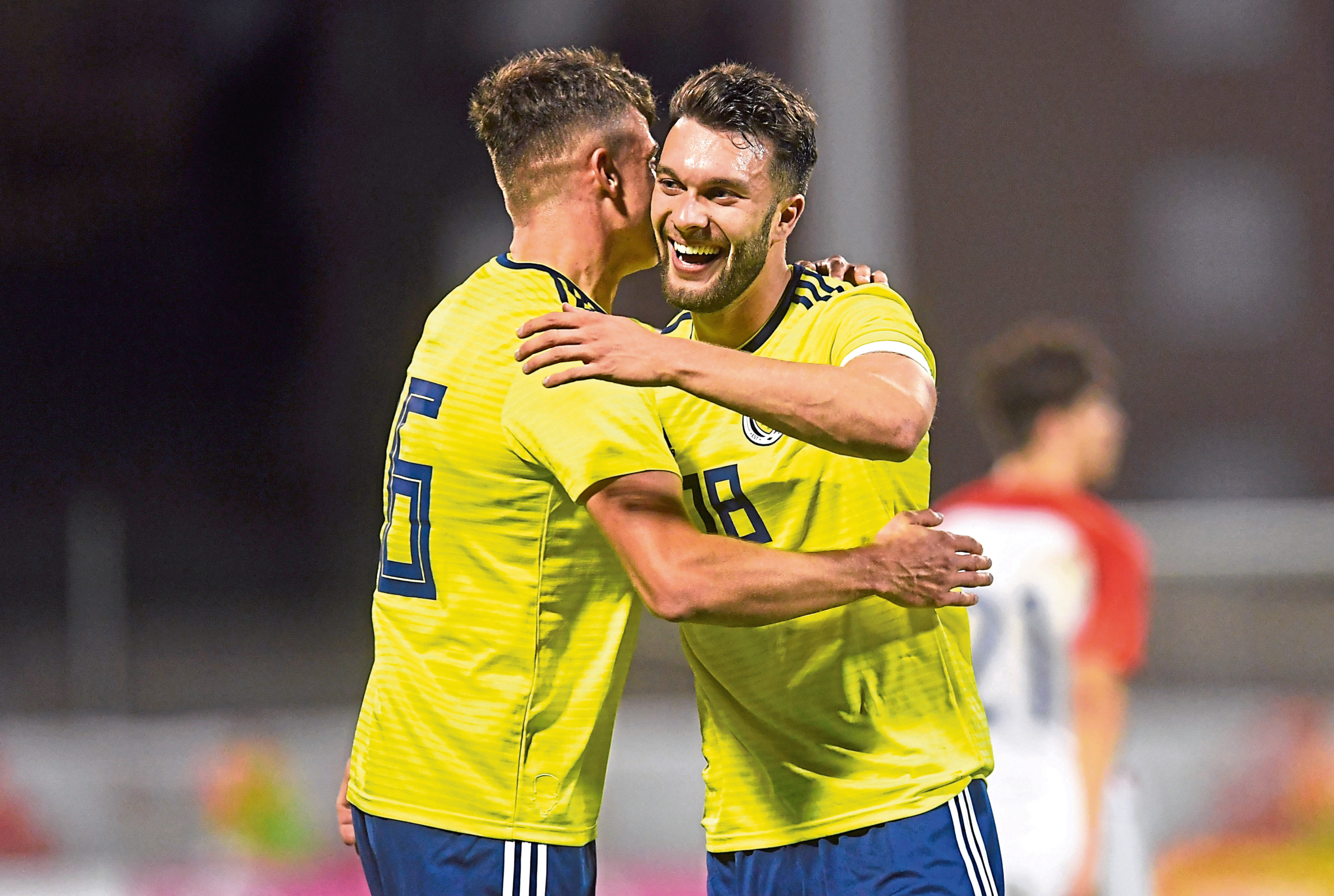 Scotland's Barry Macguire, left, and Connor McLennan celebrate his performance against Croatia.