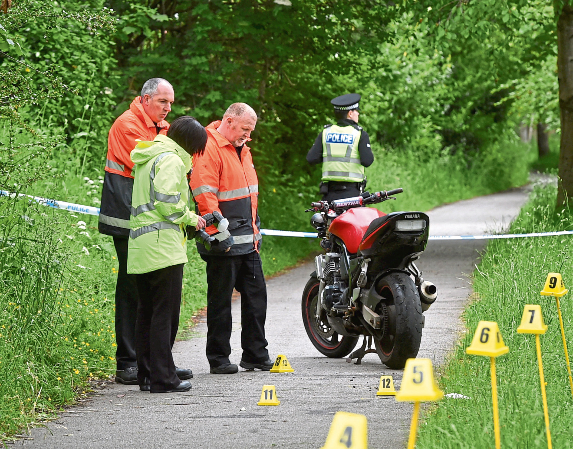 Police at the scene where Christopher Christie crashed his motorbike on the old railway line at Cults