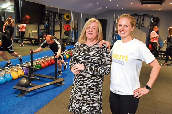 Fiona Weir, Shirley's Space manager and Carla Robertson of CPR Health and Fitness, which held a 24-hour prowler push to raise cash for the drop-in centre