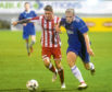 Aaron Norris, left, in action for Formartine last season during his loan spell at the club