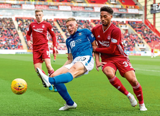 St Johnstone's Liam Gordon (left) holds off Aberdeen's Zak Vyner during the 1-1 draw at Pittodrie