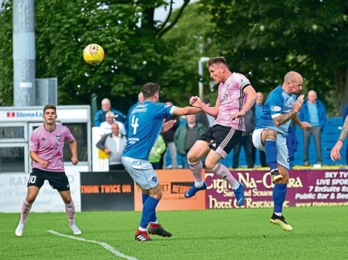 Peterhead's Rory McAllister wins a header in their recent game against Stranraer
