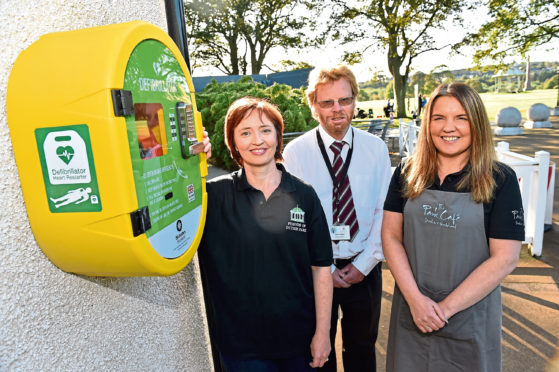 From left, Gail Gordon of Friends of Duthie Park, Alan Findlay, park officer, and Shona Morrison, park cafe manager, with the defibrillator