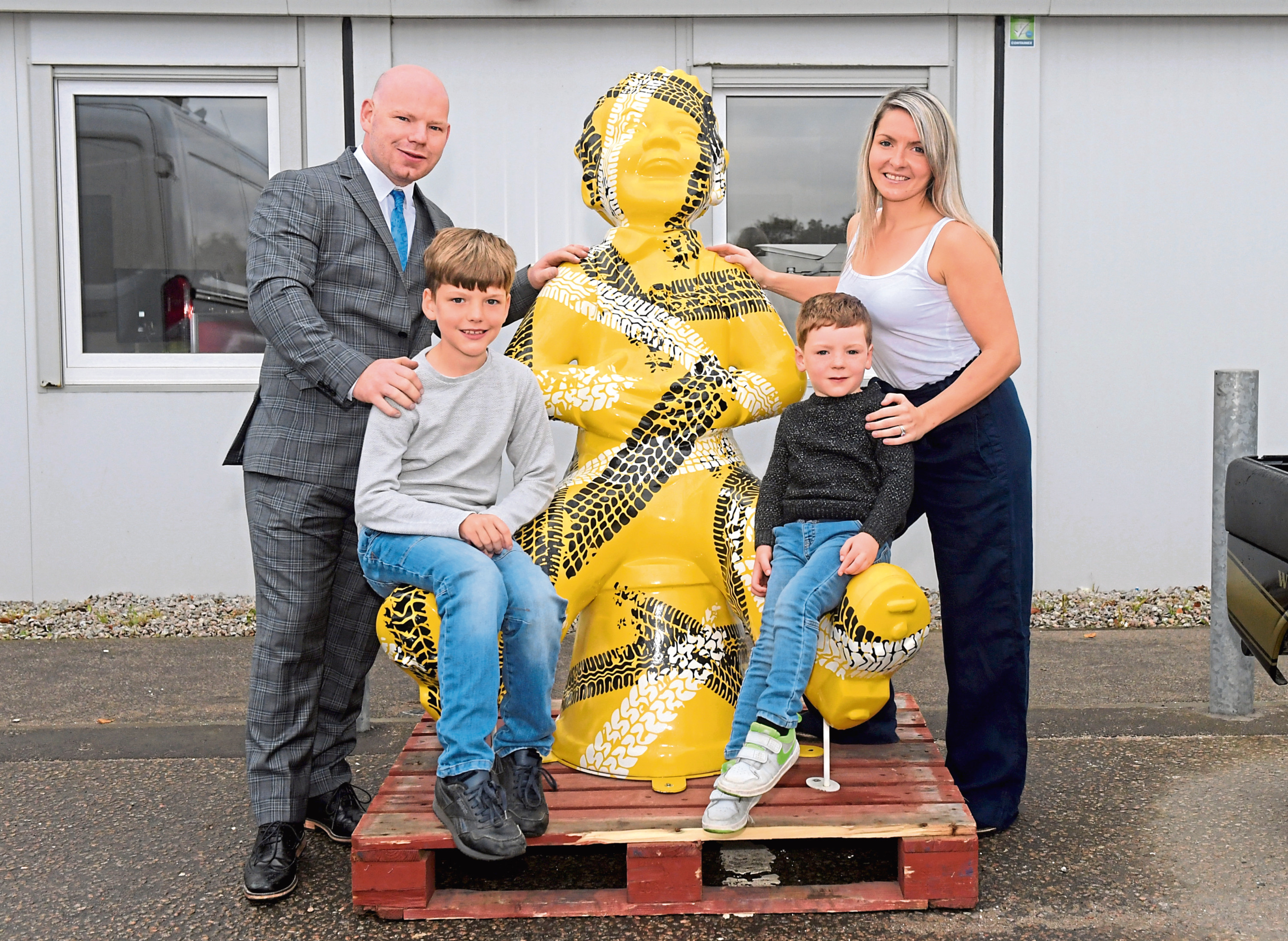 Steven and Jen Shepherd with their two boys Codey and Jude picked up Oor Roadie. Picture by Kath Flannery