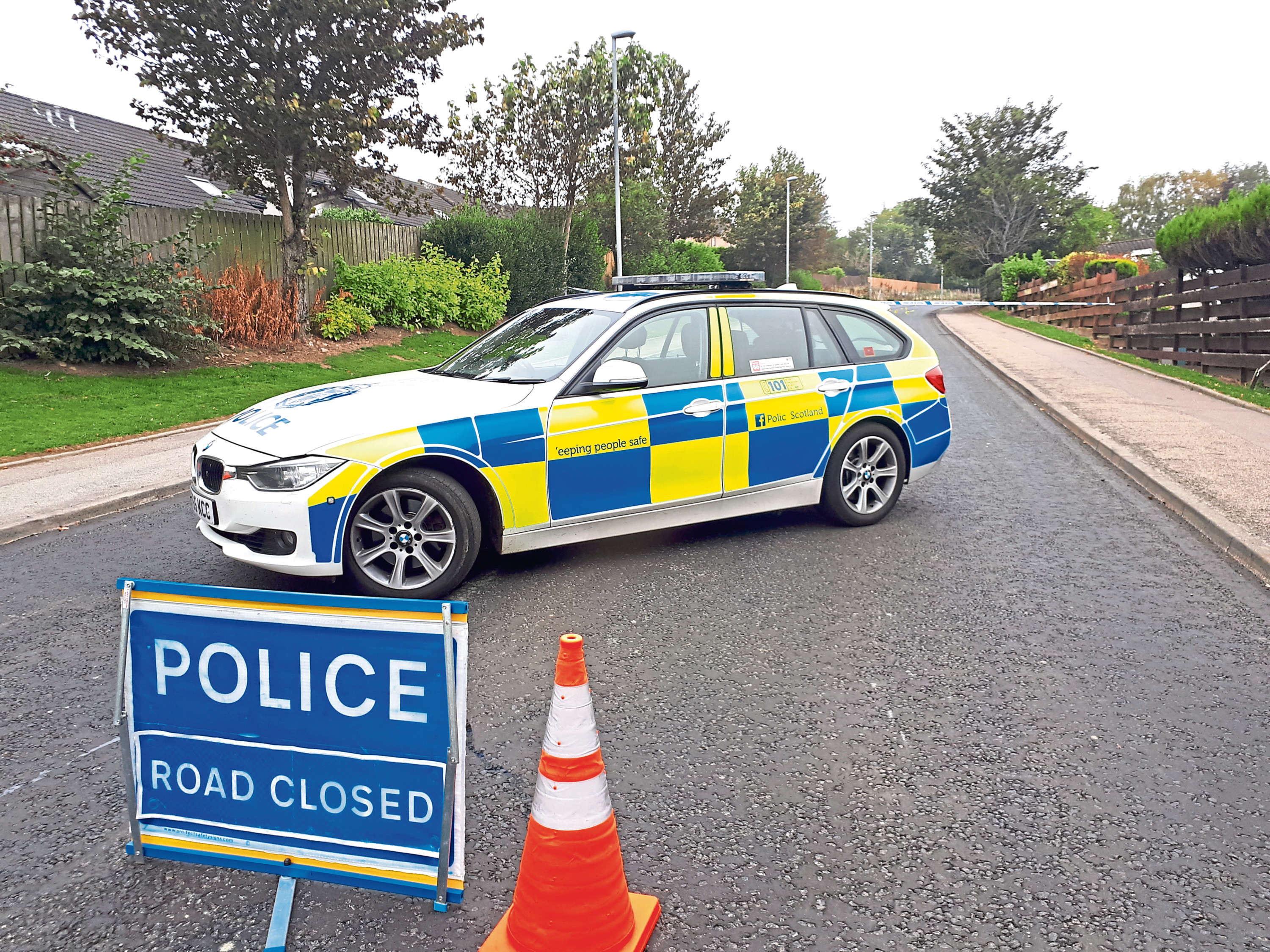 Police at the scene of the incident on Fintray Road