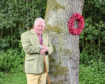 Councillor Colin Pike with the Peace Tree at Dunnottar Church