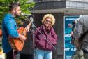 Singer-songwriter Emeli Sande with busking musician Finn Henderson Palmer