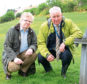 Councillor Ian Yuill and Sport Aberdeen managing director Alistair Robertson with some of the litter left at Aberdeen Snowsport Centre