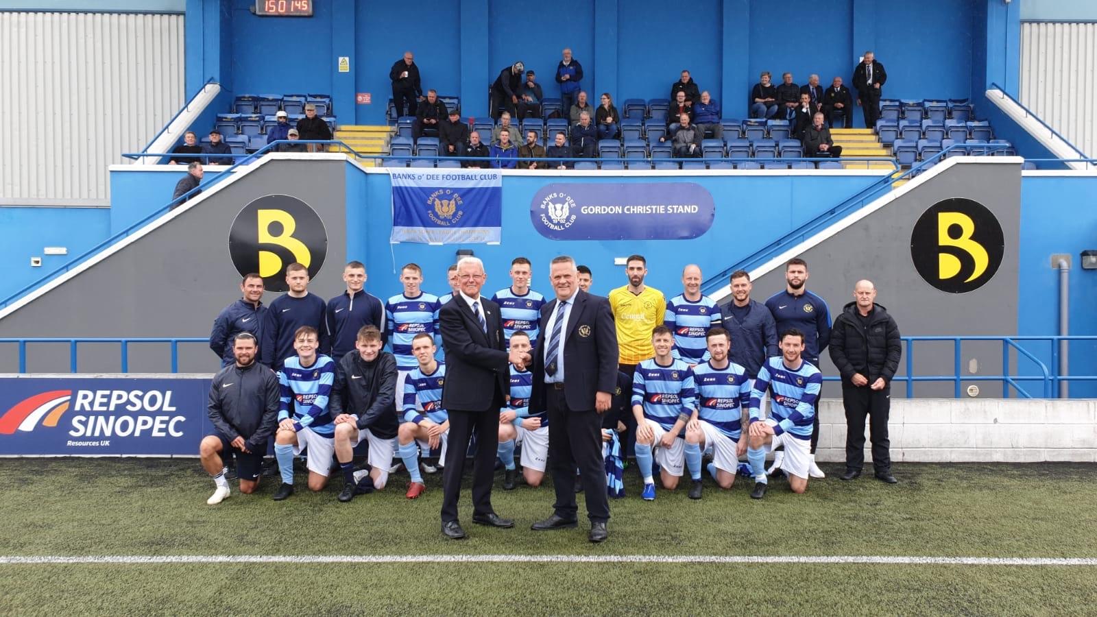 Banks o' Dee president Brian Winton congratulates Gordon Christie, left.