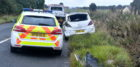 Police at the scene of the crash on the A947