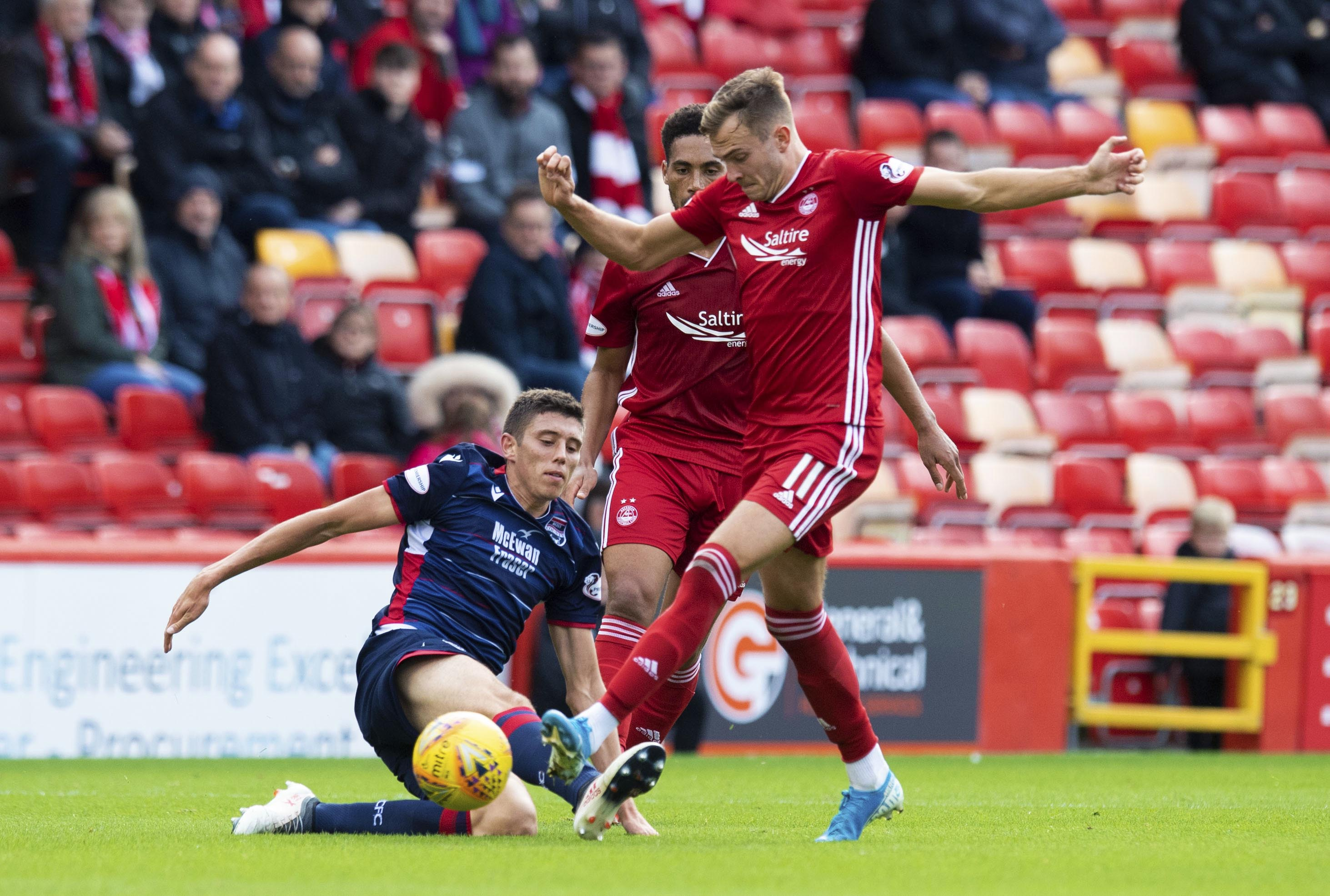Aberdeen's Ryan Hedges, right, tackles Ross Stewart during the Ladbrokes Premiership match between Aberdeen and Ross County at Pittodrie Stadium.