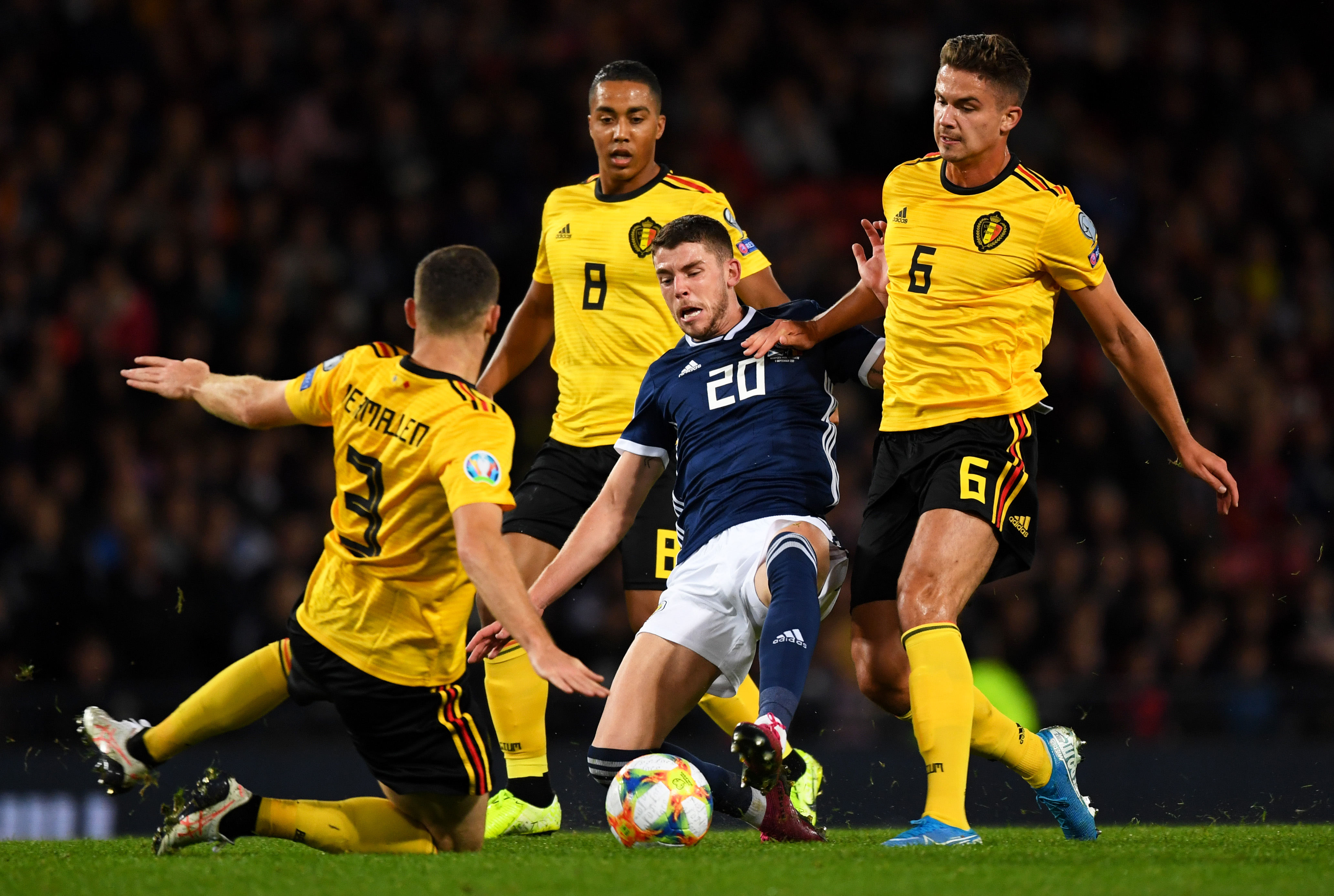 Scotland's Ryan Christie and Thomas Vermaelen during a UEFA Euro 2020 qualifier between Scotland and Belgium.