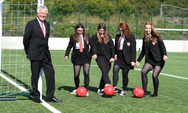 Aberdeen FC director Duncan Skinner with school pupils the Aberdeen FC Community Trust has helped