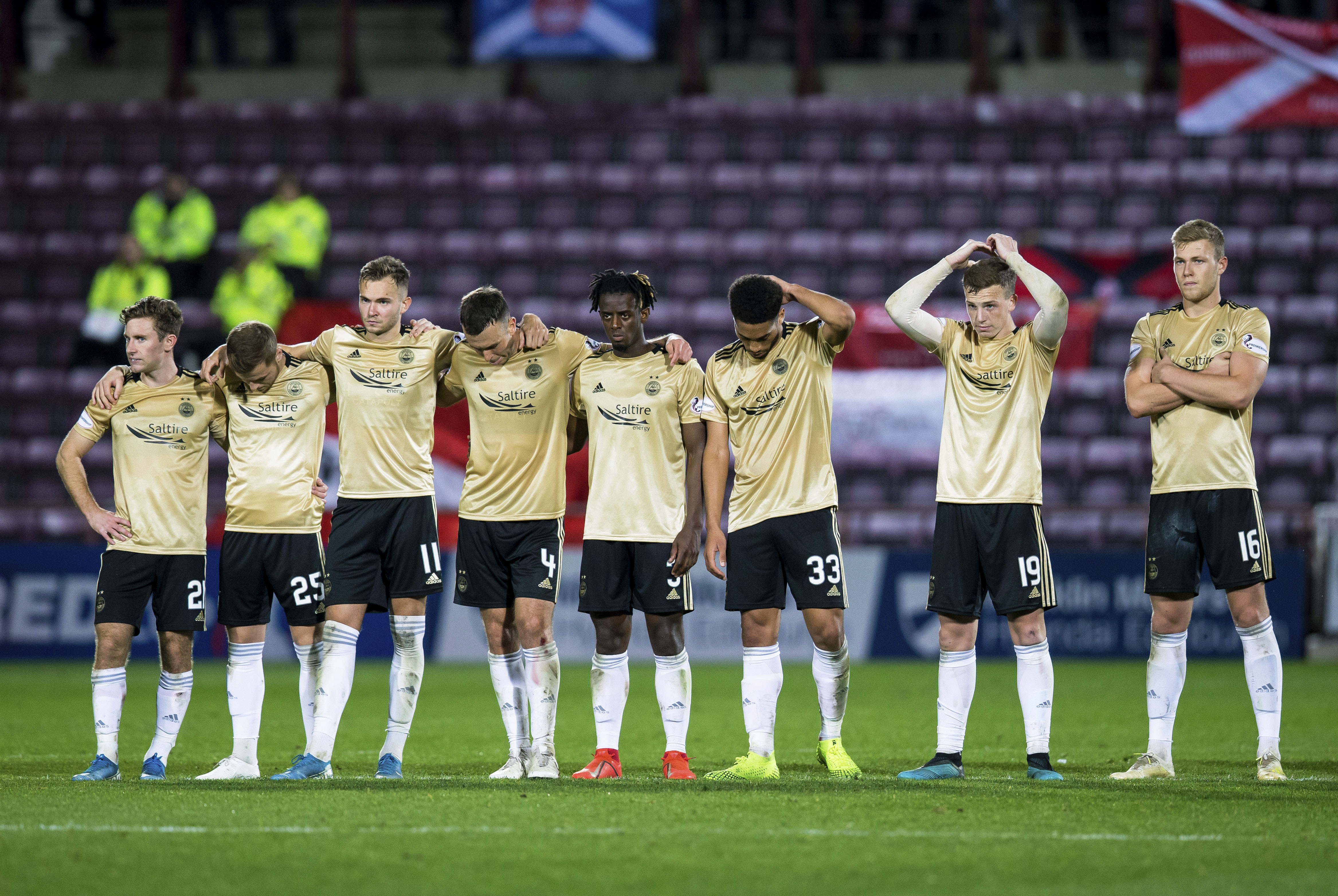 The Aberdeen players look dejected after defeat to Hearts on penalties in the Betfred Cup quarter final