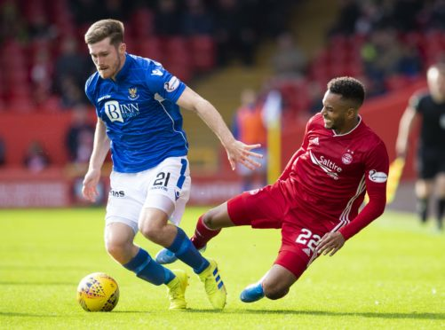St Johnstone's Anthony Ralston (left) is tackled by Aberdeen's Funso Ojo.