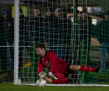 Fraserburgh goalkeeper Paul Leask saves a penalty during the shootout against Buckie Thistle