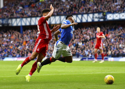 Rangers Alfredo Morelos goes down in a challenge from Zak Vyner that led to a converted penalty.