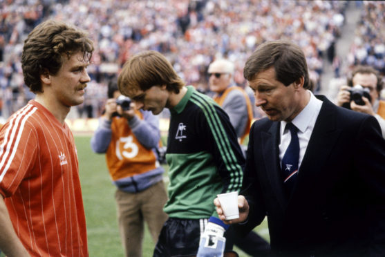 Ferguson, right, with Bell at the 1984 final. The boss was famously furious after the Dons lifted the trophy in 1983.