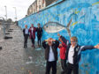 Tullos Primary pupils have taken part in a project to paint a mural opposite the school with artist Fitlike