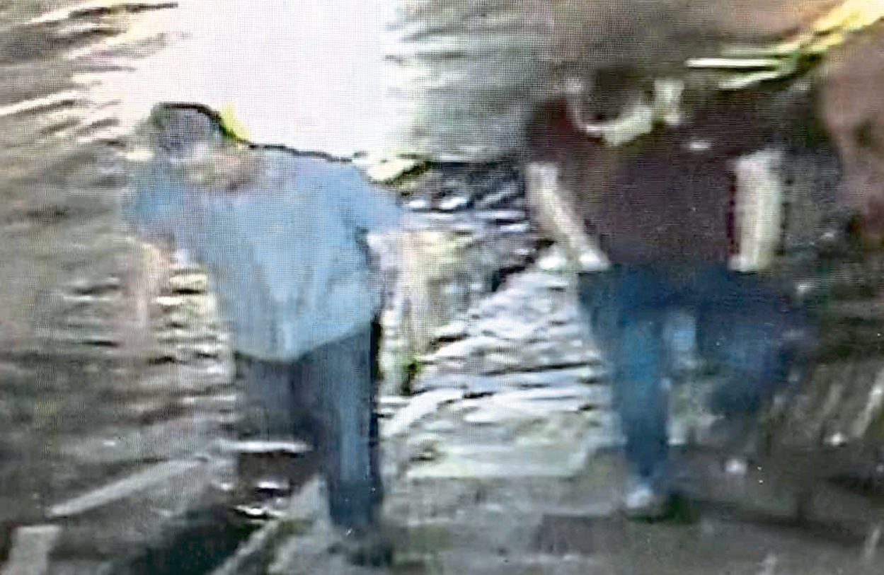 An image from CCTV footage at Will Chemists showing two men who were in the area around the time the electric vehicle was targeted