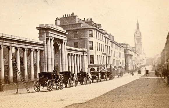 A view of Union Street by George Washington  Wilson and Son, dating from around 1872, showing the colonnade entrance to the Kirkyard of St Nicholas