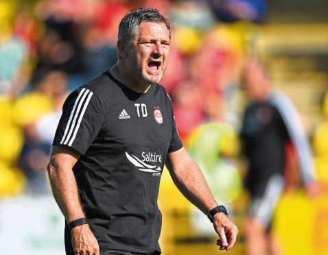 Aberdeen assistant Tony Docherty.