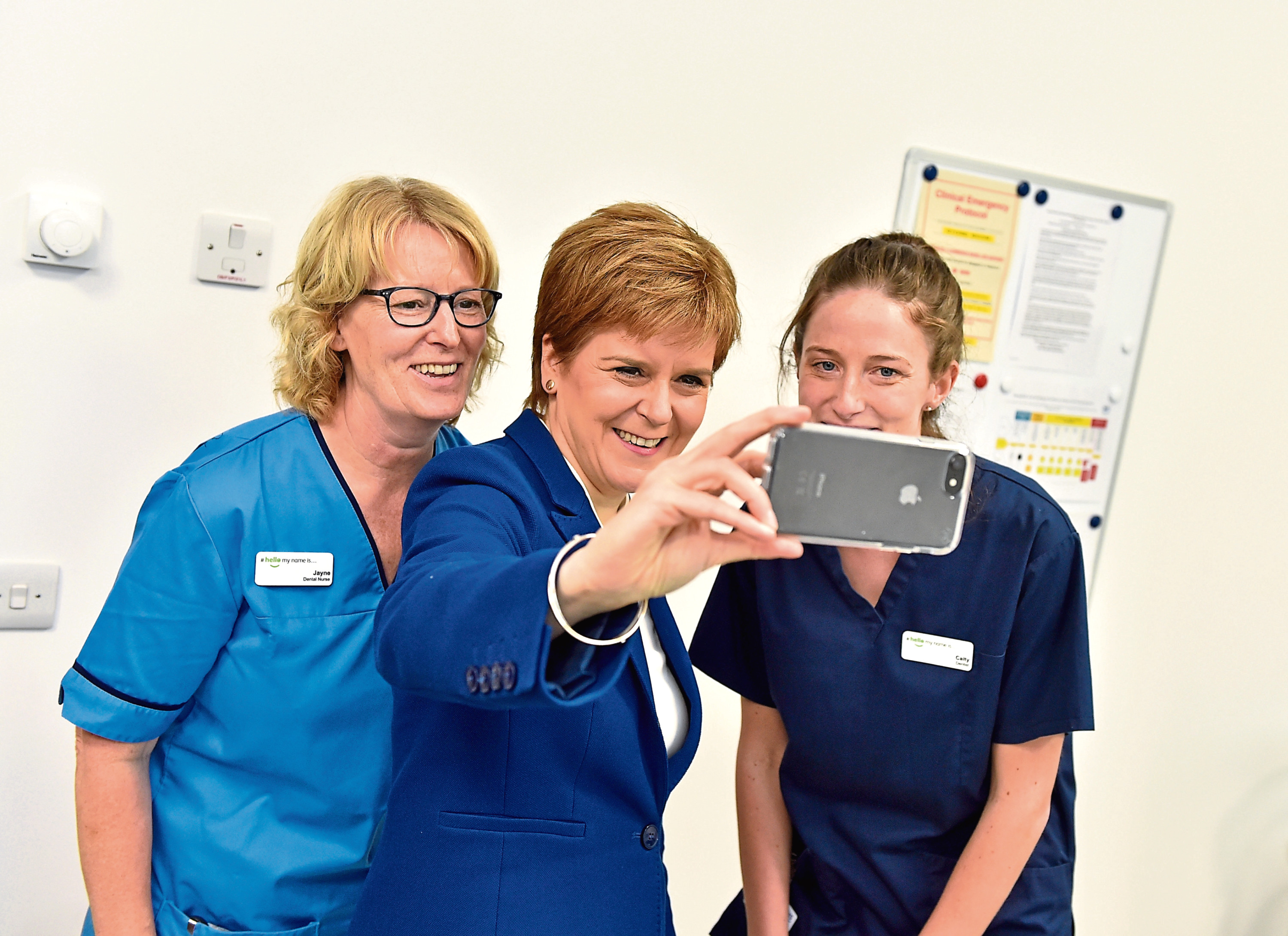 Nicola Sturgeon takes a selfie with staff at the hub. Picture by Scott Baxter