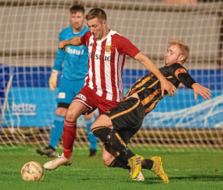 Formartine Michael Clark and Huntly's Ross Still.