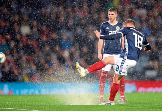 Scotland's Stuart Armstrong scores his sides sixth goal  during the UEFA Euro 2020 qualifying match at Hampden Park, Glasgow. PA Photo. Picture date: Sunday October 13, 2019. See PA story SOCCER Scotland. Photo credit should read: Steve Welsh/PA Wire. RESTRICTIONS: Use subject to restrictions. Editorial use only. Commercial use only with prior written consent of the Scottish FA. Call +44 (0)1158 447447 for further information.