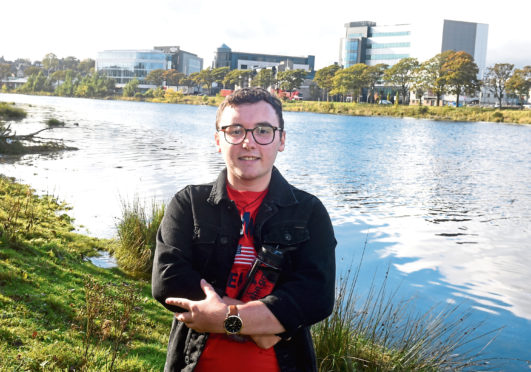 Austin Munro is encouraging businesses to offer people the chance to refill water bottles Picture by Jim Irvine
