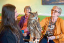 Handler William Lawson and one of his beautiful owls meets Hazel Middler and Betty Watson at the home
