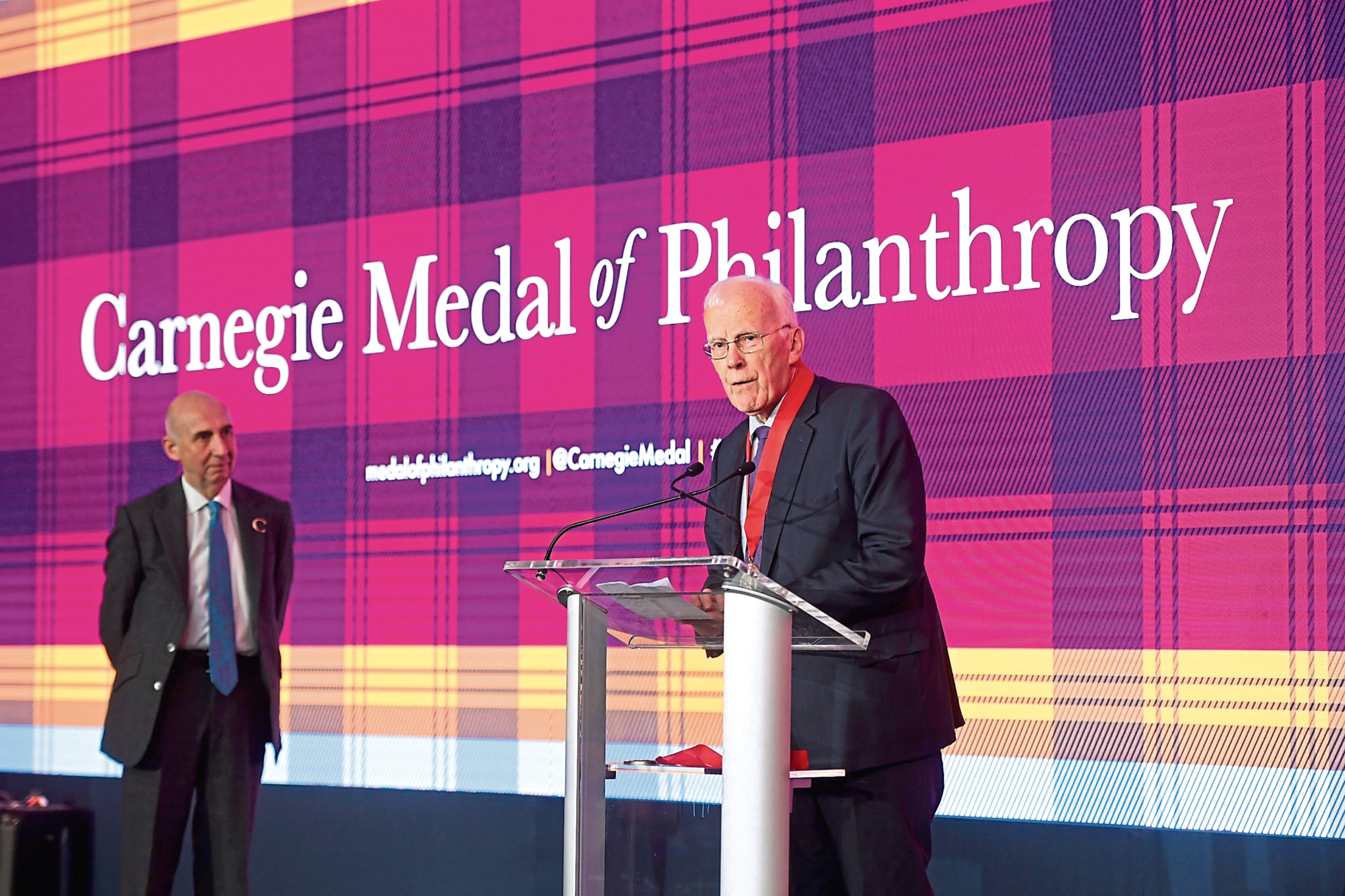 Sir Ian Wood picks up the Carnegie Medal of Philanthropy at a ceremony in New York
