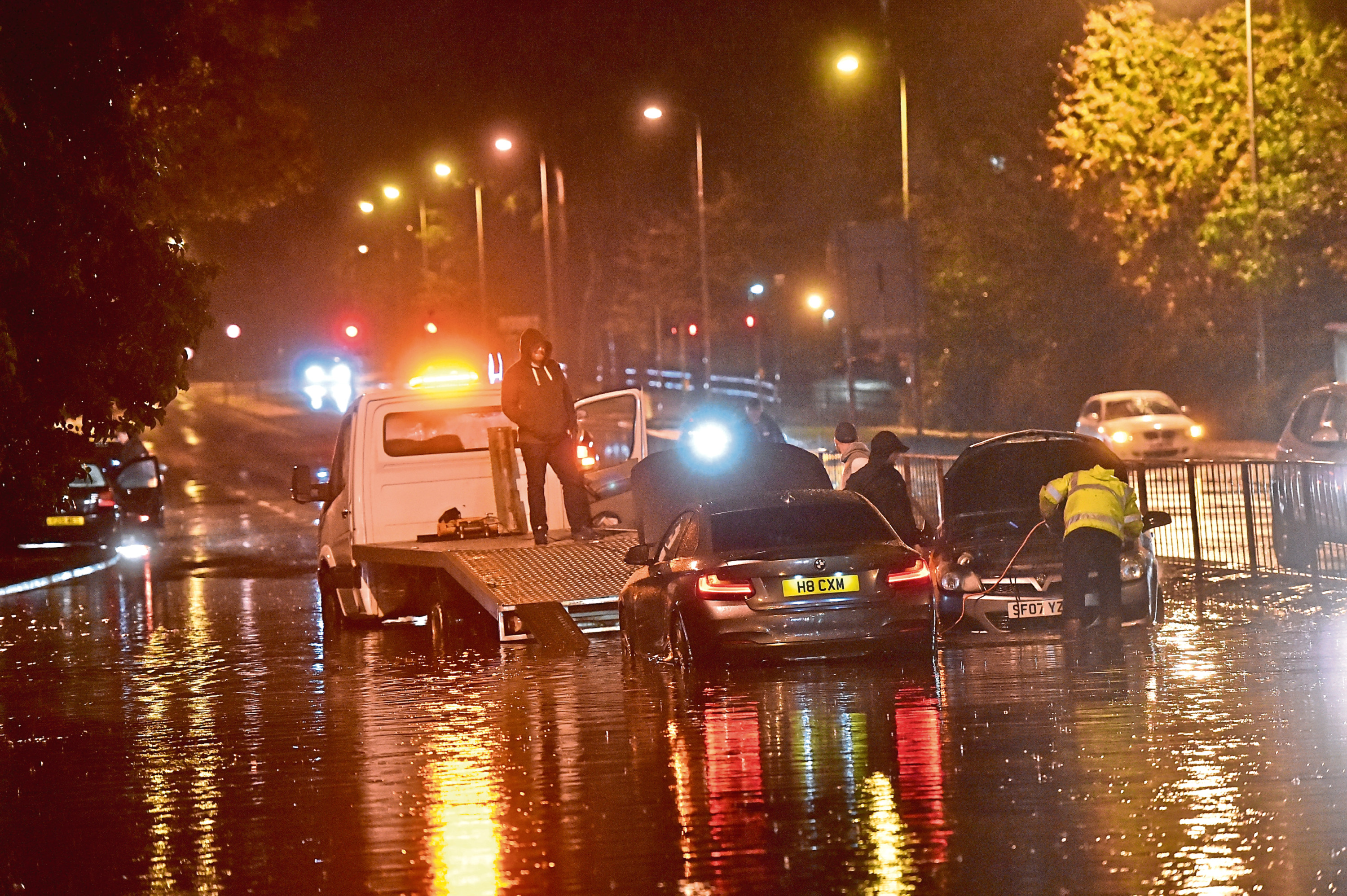 Cars being recovered from flash flooding on North Anderson Drive. Picture by Scott Baxter