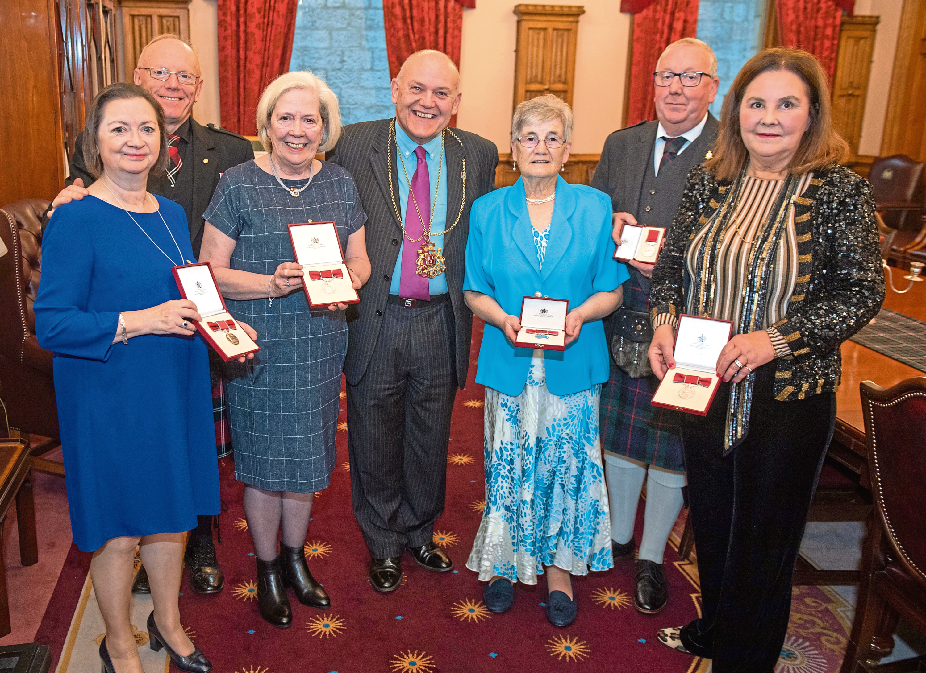 Pictured from left, Clare Haggart, Charles Bain, Elizabeth Milne, Lord Lieutenant Barney Crockett, Hazel McAllan, David Murray and Helena Anderson-Wright with their medals