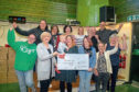 Jenny Laing, third from left, presenting the £25,000 cheque at Froghall Community Centre