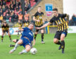 Martin Scott in action during the tie at Beechwood Park.
