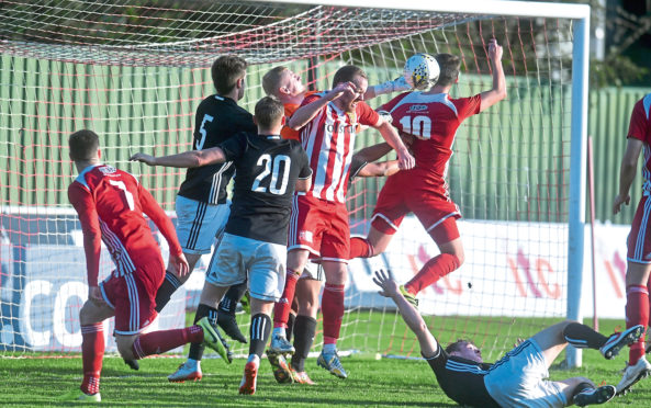 Formartine's Garry Wood and Daniel Park with Gala's goalkeeper  Fraser Norton. Pic by Chris Sumner