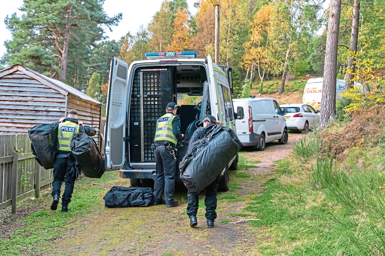 Police at the scene in Birkenhill Woods